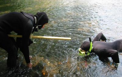Photo of researchers checking Toccoa survey method.