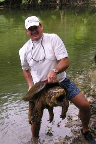Photo of Prentice Eager with a 72-pound snapping turtle